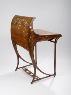 Carlo Zen |  Writing desk, ca. 1902. Fruitwood, brass, white metal, mother-of-pearl, leather.