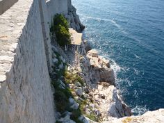 On the Dubrovnik wall looking down at the cafe on the cliff.
