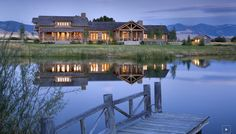 Amazing and natural landscaping surrounds this Montana log home....gorgeous!