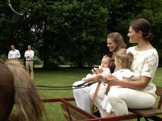 royalwatcher:  New photos from the SVT's Kungafmiljen 2014, showcasing the best of the Swedish Royal Family's photos and videos-Princess Madeleine holding baby Princess Leonore and Crown Princess Victoria holding Princess Estelle with proud dads Chris O'Neill and Prince Daniel in the background