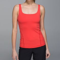 NWT Lululemon Amala Tank - Coral 4 NWT Lululemon Amala Tank, size 4. This coral tank has a built in bra, with adjustable band (see picture) and medium support.  Other prints are currently available on the site if you want to read more about it.  lululemon athletica Tops Tank Tops