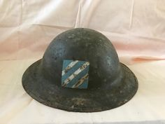 """This is the real deal. From 1917 this World War One Helmet belonged to soldier who was part of the 4th infantry regime, 3rd division which became known as the """"Marne Division"""". It was this division that held their position at the Marne River defeating the Germans bid for Paris, which is how this group got the Nickname."""