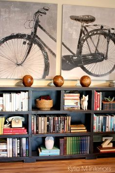 Ideas for home decor with a long low bookcase, arrange books by colour and use accessorizes in groups of 3. Oversized bike artwork on canvas