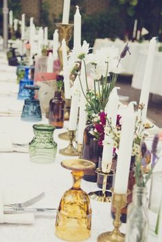 use retro coloured and not coloured, recycled amber jars as vases for flowers, recycled candle holders for candles..