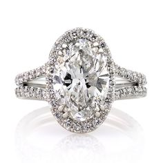 This magnificently beautiful oval cut diamond ring has the most amazing combination you have ever seen! The remarkable 3.41ct oval cut diamond set in the center is AGS certified (one of the leaders in diamond grading) at F-SI2, exceptionally white and perfectly eye clean! This is one of the best SI2s you will ever see! The inclusion is a white feather on the side of the diamond that is hardly visible under 10X magnification! The cut is exceptionally beautiful as well. It sparkles…