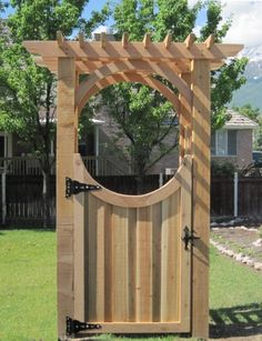 dont you think that trellis topped gate with oval opening is charming i