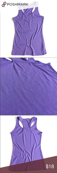 Athleta Tank Top Athleta Tank Top ▫️Color: Purple (color is slightly different on pictures) ▫️Material: 60% polyester, 40% poly minerale ▫️Fit: True to Size (see measurements) ▫️Perfect for Working Out  ▫️Small amount of pilling throughout top Good Preowned Condition 🚫No Trades🚫 lululemon athletica Tops Tank Tops