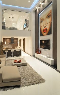 Beautiful interior with high ceiling, glass wall on 2nd floor, color scheme and more! luxurious interior design ideas perfect for your projects. #interiors #design #homedecor www.covetlounge.net