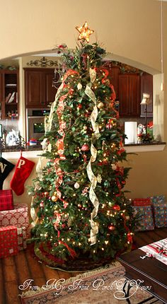 """Totally going for the """"cascading ribbon"""" effect on the tree next Christmas instead of traditional garland!"""