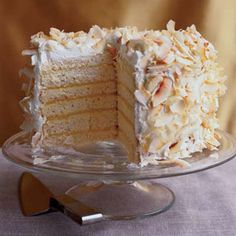 """This towering dessert is made up of layers of super-moist, almost puddinglike coconut cake spread with tangy passion fruit curd, then topped with whipped cream and crispy flakes of toasted coconut. The recipe is from Cynthia Wong, pastry chef in Decatur, Georgia. The cake may look intimidating, but it's easy to make: """"Just pop the layers out of the baking pans and slap them together,"""" Wong says."""