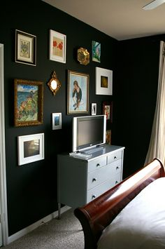 Gallery wall around TV - successful way to integrate the television.