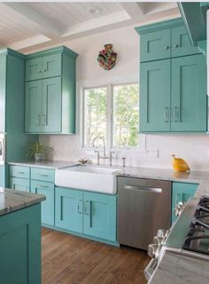 """Turquoise kitchen cabinets with white farmhouse sink // Sherwin-Williams """"Comp. Turquoise kitchen cabinets with white farmhouse sink // Sherwin-Williams """"Composed"""" SW 6472 Always wanted . Turquoise Kitchen Cabinets, Rustic Kitchen Cabinets, Rustic Kitchen Design, Kitchen Cabinet Styles, Farmhouse Style Kitchen, Painting Kitchen Cabinets, Kitchen Paint, Diy Kitchen, White Farmhouse"""