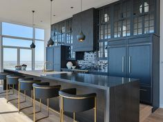 Contemporary black kitchen features three Tom Dixon Beat Light Pendants #LGLimitlessDesign #Contest #kitchendesign