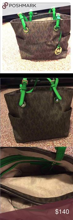 Michael Kors bag Beautiful bag, authentic. Green handles. A lot of room with many compartments, carried several times. Has minor staining on the inside at the bottom. Michael Kors Bags