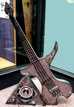 Recycled steel Garden Or Yard / Outside and Outdoor sculpture by artist Jaak Kindberg titled: 'Bass Station (Modern Steel Guitars Musical Instrument statue/sculpture)'