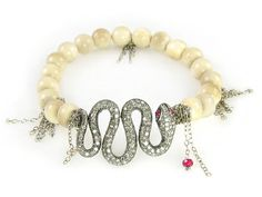 I love this! I'd wear it every day! > woolly mammoth ivory, diamonds and rubies. nanfusco.com