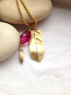 """I love the idea of combining charms and beads like this.  """"Long Gold Necklace Gold Feather Pendant Dark Fuchsia by Annyse"""""""