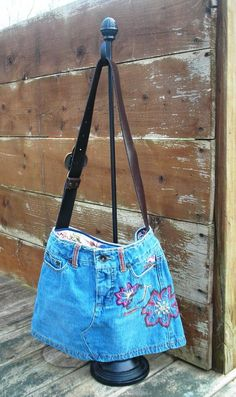 Embroidered flower denim bag. $25.00, via Etsy.