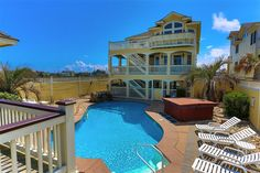 PARADISE VI, #226 l Kill Devil Hills, NC - Outer Banks Wedding and Event Home l Oceanfront home providing 10 bedrooms (7 master suites), elevator, recreation lounge, sports bar, home theater, loft, gourmet kitchen, private pool (option to heat), poolside cabana with rooftop sun deck, sauna, hot tub, private beach walkway and more! l www.CarolinaDesigns.com