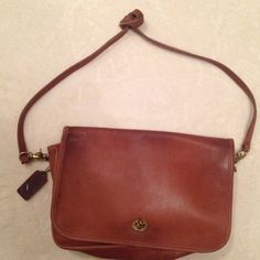 Authentic Coach leather Dinky bag Authentic Coach brown leather Dinky bag. Strap has been tied for shorter length. Small water spot in front as indicated in photo. Price reflects wear. Coach Bags Shoulder Bags