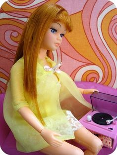 Barbie listening to record
