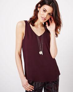 This flowy cami will give a lovely feminine touch to your day-to-evening looks. Pair it with jeans or a pencil skirt.<br /><br />- Sleeveless<br />- Front and back v-neck<br />- High-low hem<br />- Double layer