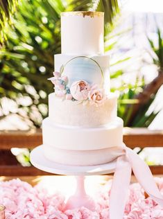 Pink, blue and gold wedding cake