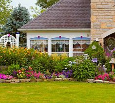 The front border brims with petunias and heliopsis among other blooms. More from this home's garden: http://www.midwestliving.com/garden/featured-gardens/garden-tour-english-style-cottage-garden-ohio/?page=11