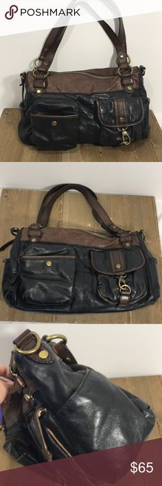 Fossil brown and black leather shoulder bag Timeless Fossil shoulder bag. Black leather body with brown top, straps and piping. Bronze hardware. Two front pockets. Two side pouches on each end. Top zips closed. Inside has one zipper pocket and two pouches. Vintage vibe! There are scuffs especially on the top brown part of bag, inside has some stains. Corners have some scuffing. Approximate measurements height 9 3/4, width 13.5, depth 3 1/4, handle drop 9.5. Fossil Bags