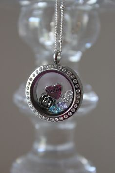 """Custom locket by Origami Owl with """"family"""" heart, birthstones, vintage rose and crystal puffy heart. You can design your locket at www.krisdee.origamiowl.com. Follow us on facebook for giveaways, new product info, events and more: www.facebook.com/locketstories."""