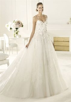 Dione from the Elie by Elie Saab 2013 collection for Pronovias is made of delicate tulle and is deco
