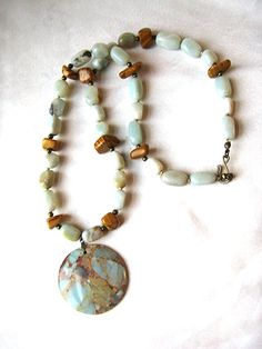 Earthy impression stone, aqua terra jasper, amazonite & tiger jasper necklace by WildThingsAdornments. The whole piece is gorgeously boho, with a southwest and tribal/global flair. I absolutely love this necklace--and I thank you for checking it out!  #etsy #etsyfind #chaoscurators #wildthingsadornments