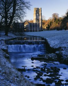 Winter sunlight on Fountains Abbey in North Yorkshire, with sprinkling of snow on ground. ©National Trust Images/Andrew Butler.
