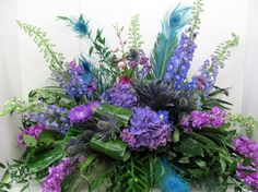 Cathy Walsh's profile photo  Cathy Walsh  3. Funeral flowers in blues and purples with peacock