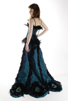 The herl makes this long peacock burlesque costume! Click through to this flikr to see scantier visuals from the front!
