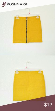 Mustard Yellow Mini Skirt Bodycon zip up mini skirt. The zipper is functional. Very stretchy.   Brand: Divided by H&M Size: 4 Condition: perfect, no flaws. Gently worn.  #Bodycon #bodyconskirt #mini #skirt #miniskirt #mustard #yellow #mustardyellow #hm #divided #clubwear #cluboutfit #summer #summerfashion #summerstyle #fashion #style #cheap #styleforcheap #xoxopf #bundleandsave H&M Skirts Mini