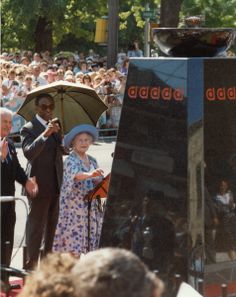 The Queen Mother lights the Flame of Hope on her visit to Banting House in 1989.