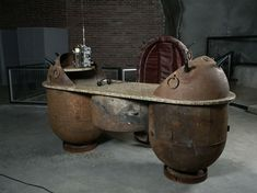 Furniture made from WWII sea mines: perfect for decorating your super villain lair.