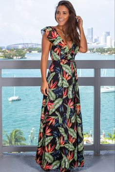 Get this pretty Black Tropical Wrap Dress from Saved by the Dress Boutique. This wrap maxi dress features a fabulous tropical print with ruffle detail. Over 50 Womens Fashion, Fashion Over 50, Maxi Wrap Dress, Floral Maxi Dress, Summer Wedding Outfits, Cute Dresses, Maxi Dresses, Maxi Robes, Tropical Dress