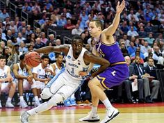 North Carolina forward Theo Pinson drives to the basket