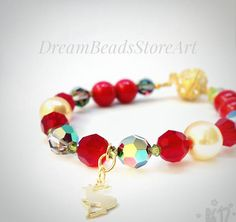 Crystal bangle Small deer Christmas gold deer Swarovski vitrail Ruby red crystal Gold pearl Swarovski Red coral pearl Crystal mix jewelry Multi color bracelet Best holiday gift Winter bracelet Women Xmas bracelet Xmas gift idea Additional items purchased in the same order ship free!  Round pearl winter bracelet looks so elegant and festive! This crystal mix jewelry could be the best holiday gift or great as Xmas gift idea! Crystal bangle is ideal women Xmas bracelet! Winter multi color…