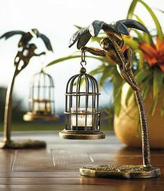 Crafted from all-weather aluminum with a hand-applied bronze and verdi finish, this playfully exotic candleholder is sure to spark conversation wherever it is displayed.