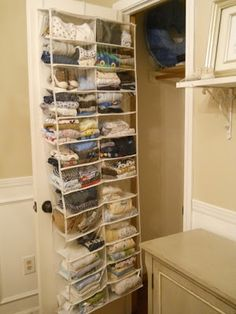 Shoe organizer behind the main door for blankets, shoes, etc