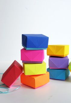 Learn how to make these hand-folded DIY Paper Boxes