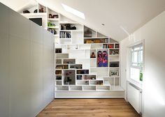 The latest residence to feature a combined staircase and bookshelf is this loft conversion in north London.