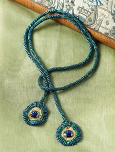 "An easy twisted herringbone rope provides support for two gorgeous beaded ""peacock"" feathers! Learn how to make this #beadedrope project and 4 others in this FREE ebook! #beading"