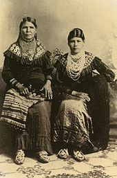 Jennie Bobb and her daughter, Nellie Longhat of the Delaware Nation. Photo taken in Oklahoma in 1915 after they were forced to migrate from their ancestral territory to Indian Territory. (Wikipedia, the free encyclopedia)