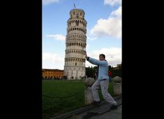 Tourists 'Holding' Up The Leaning Tower Of Pisa