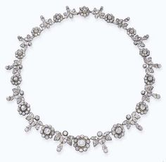 AN EARLY 19TH CENTURY DIAMOND NECKLACE   Designed as fourteen graduated old-cut diamond clusters to the ivy-leaf and pendant spacers, mounted in silver and gold, circa 1820, 39.0 cm long