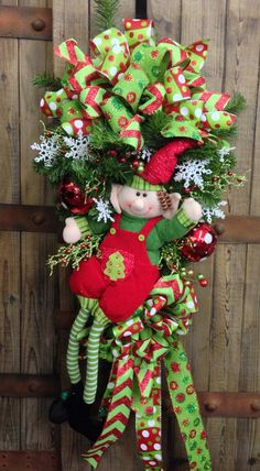 Whimsical Elf Door Swag by WilliamsFloral on Etsy Christmas Swags, Christmas Door, Christmas 2014, Holiday Wreaths, All Things Christmas, Holiday Decor, Grinch Christmas, Green Christmas, Christmas Ideas
